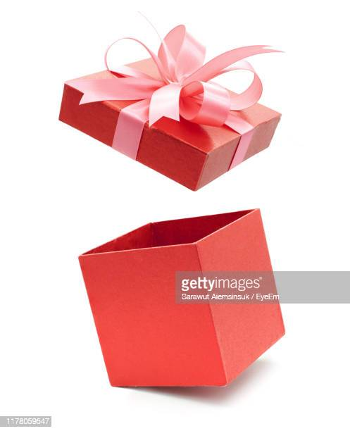 close-up of red gift box against white background - caja de regalo fotografías e imágenes de stock