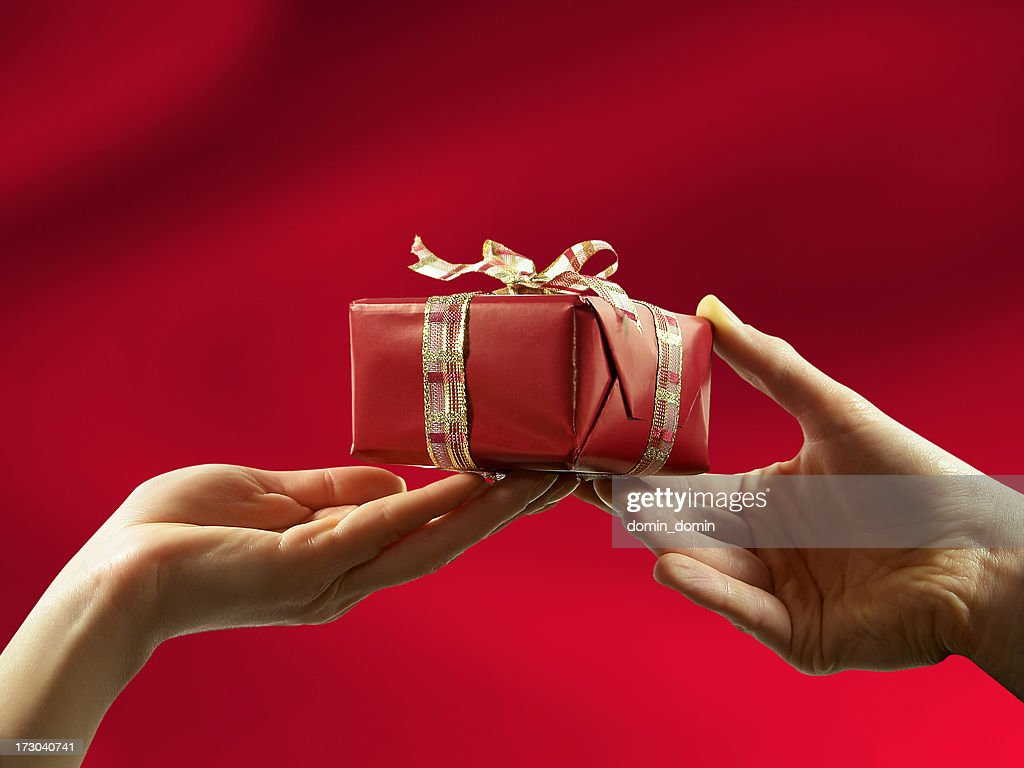 Closeup of red gift giving from man to woman stock photo getty close up of red gift giving from man to woman stock photo negle Images