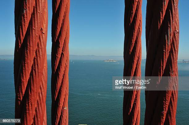Close-Up Of Red Golden Gate Bridge Steel Cables Against San Francisco Bay