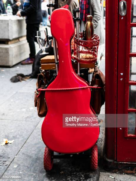 close-up of red guitar case on street - guitar case stock pictures, royalty-free photos & images