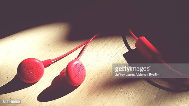 Close-Up Of Red Headphones On Table