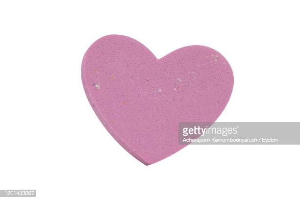close-up of red heart shape over white background - candy heart stock pictures, royalty-free photos & images