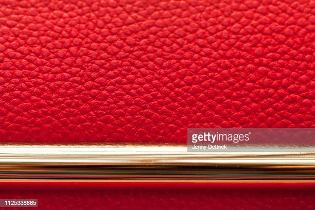 close-up of red leather handbag with gold - red leather purse stock pictures, royalty-free photos & images