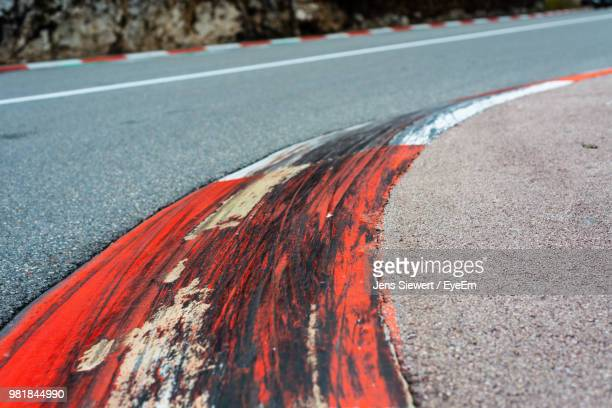 close-up of red marking on road - jens siewert stock-fotos und bilder