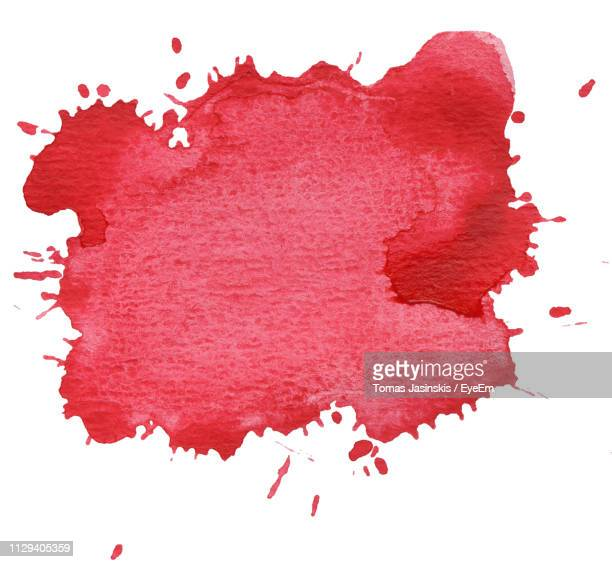 close-up of red paint splash on white background - splattered stock pictures, royalty-free photos & images