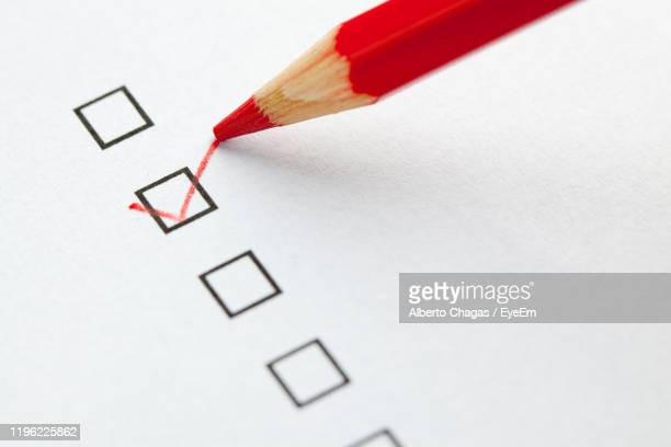 close-up of red pencil on paper - questionnaire stock pictures, royalty-free photos & images