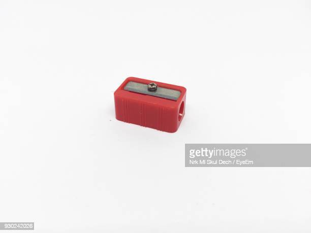 Close-Up Of Red Pencil Sharpener Over White Background