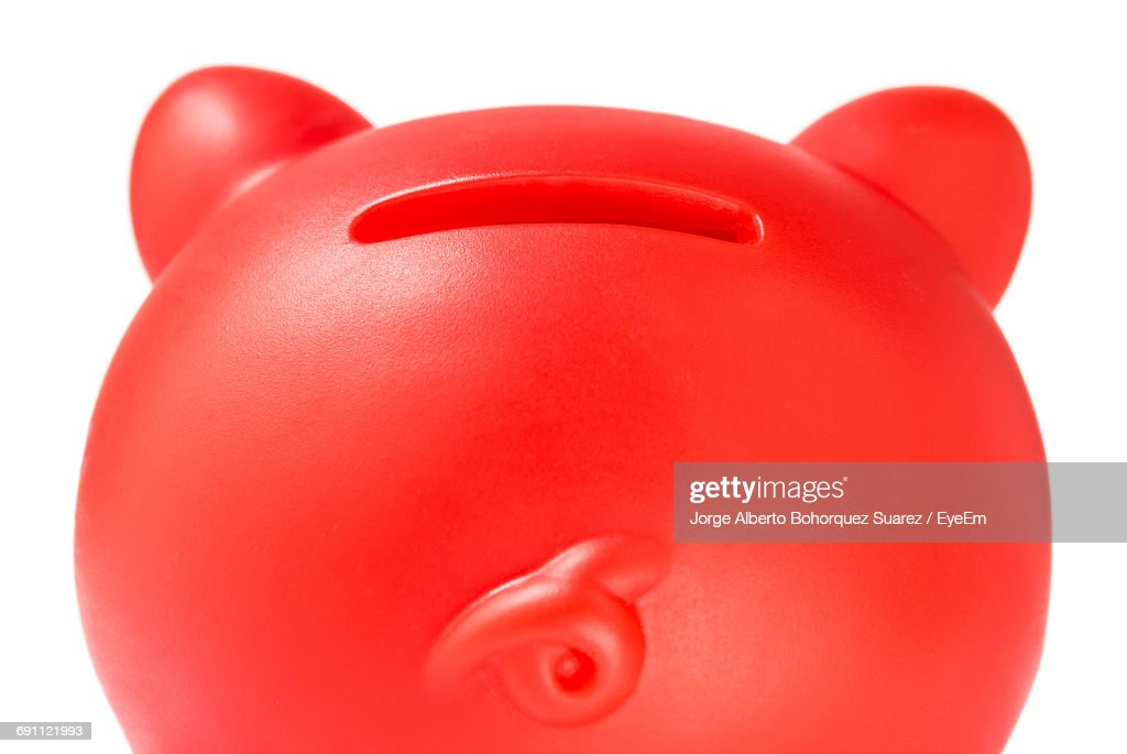 Close-Up Of Red Piggy Bank Against White Background : Foto de stock