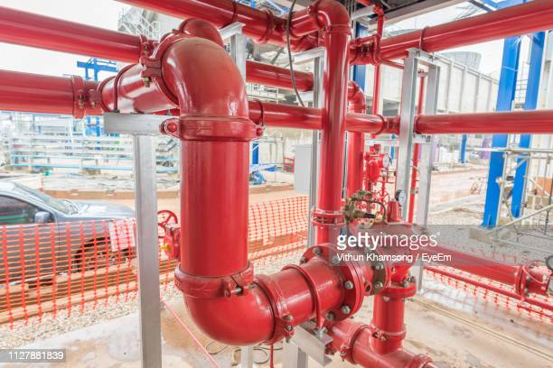 close-up of red pipe - red tube stock photos and pictures
