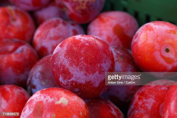 Close-Up Of Red Plums In Container For Sale At Market