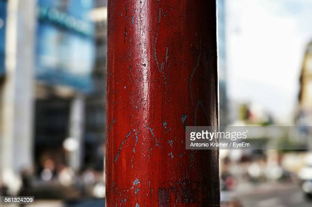 Close-Up Of Red Pole On Street