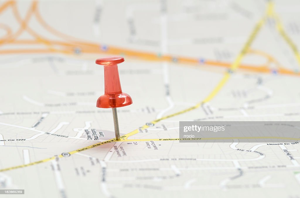 Close-up of red pushpin on a map : Stock Photo
