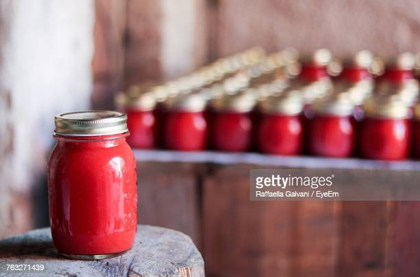 Close-Up Of Red Sauce In Jar