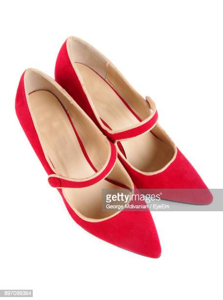close-up of red shoes over white background - 赤の靴 ストックフォトと画像