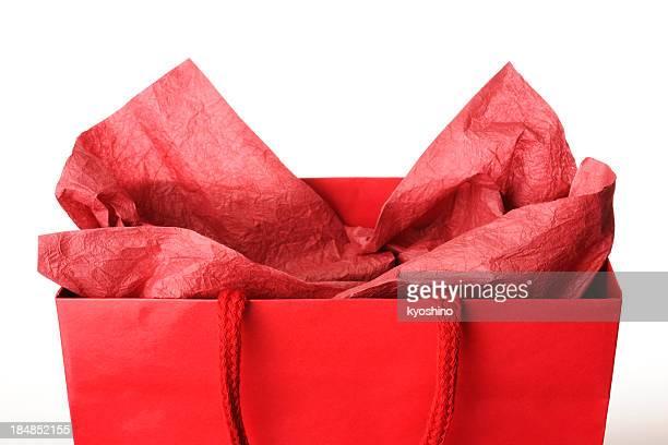 Nahaufnahme von roten Einkaufstasche mit Dekoration auf weißem Hintergrund