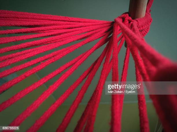 Close-Up Of Red Strings Tied To Pole