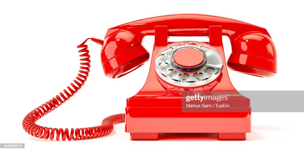 Close-Up Of Red Telephone On White Background : Stock Photo