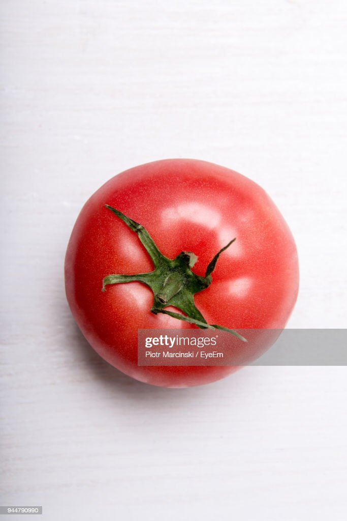 Close-Up Of Red Tomato Over White Background : Stock Photo