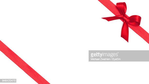 close-up of red umbrella against white background - rot stock-fotos und bilder