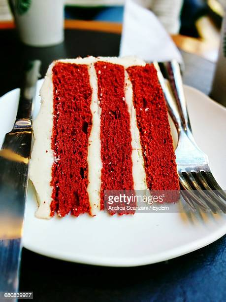 Close-Up Of Red Velvet Cake Slice In Plate On Table