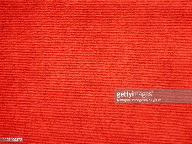 close-up of red wall - teppich stock-fotos und bilder