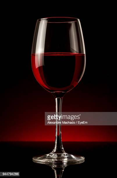 close-up of red wine on table - wine glass stock pictures, royalty-free photos & images