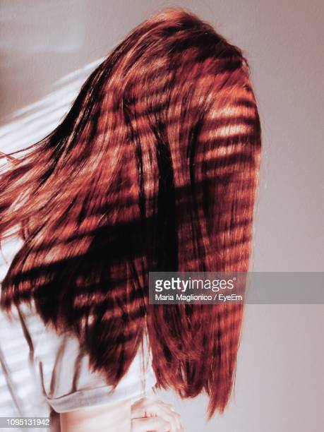 Close-Up Of Redhead Woman Against Wall