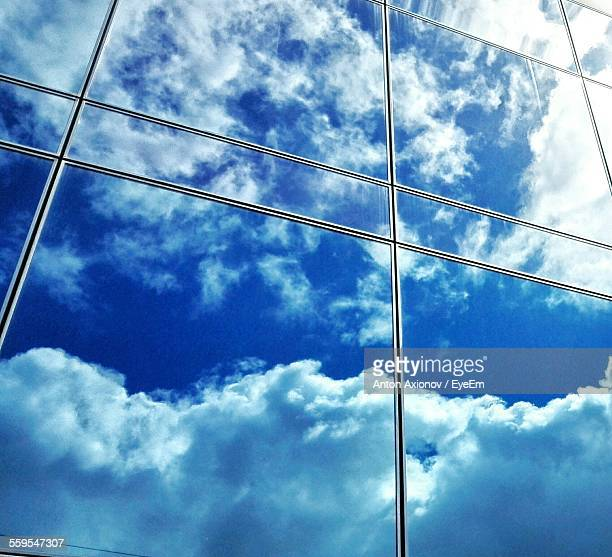 Close-Up Of Reflection On Glass Window Of Modern Building