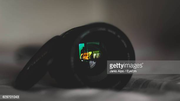 Close-Up Of Reflection On Lens On Table