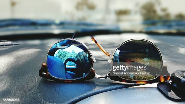 Close-Up Of Reflection On Sunglasses At Car Dashboard