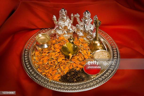 close-up of religious offerings in a diwali pooja thali - goddess lakshmi stock photos and pictures