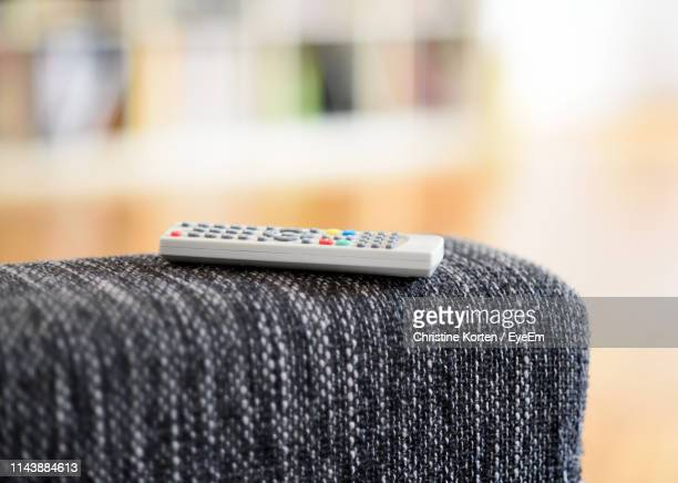 close-up of remote control on sofa - westeuropa stock-fotos und bilder