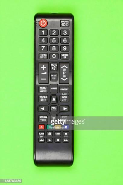 close-up of remote control on table at home - controllato a distanza foto e immagini stock