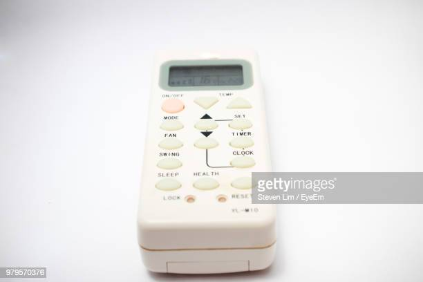 Close-Up Of Remote Control Over White Background