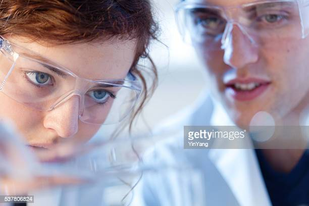 Close-up of Research Scienctists Chemists Working in Laboratory Horizontal