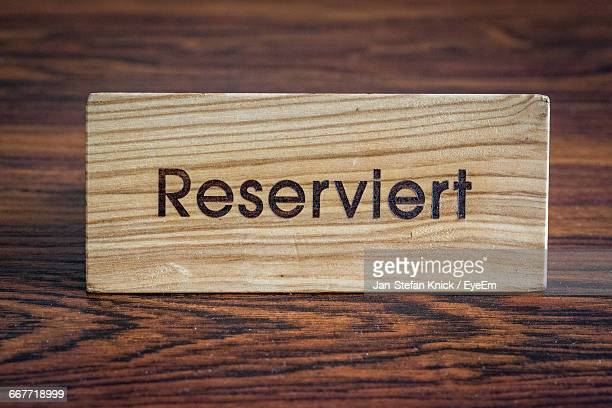 Close-Up Of Reserve Sign On Table
