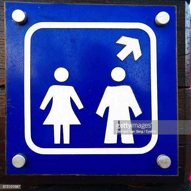 Close-Up Of Restroom Sign On Road