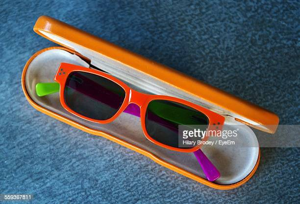 Close-Up Of Retro Styled Sunglasses In Case On Table