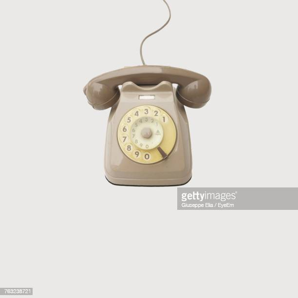 Close-Up Of Retro Styled Telephone Against White Background
