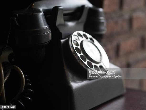 Close-Up Of Retro Telephone On Table