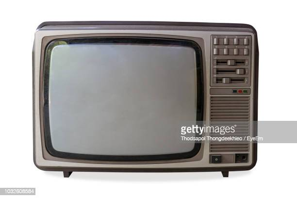 close-up of retro television set against white background - obsolete stock pictures, royalty-free photos & images