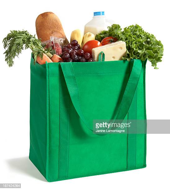 close-up of reusable grocery bag filled with fresh produce - shopping bag stock pictures, royalty-free photos & images