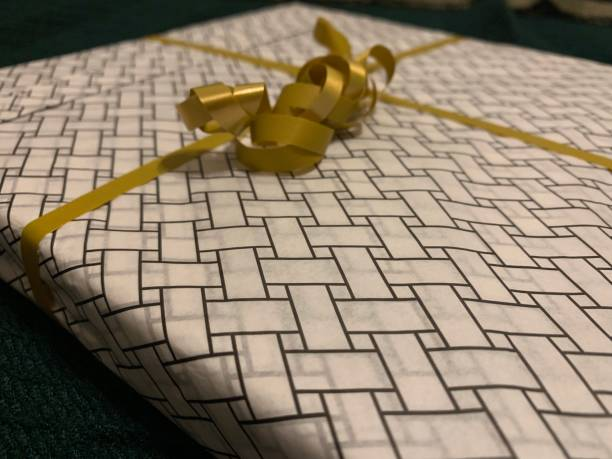 Close-Up Of Ribbon Tied On Gift