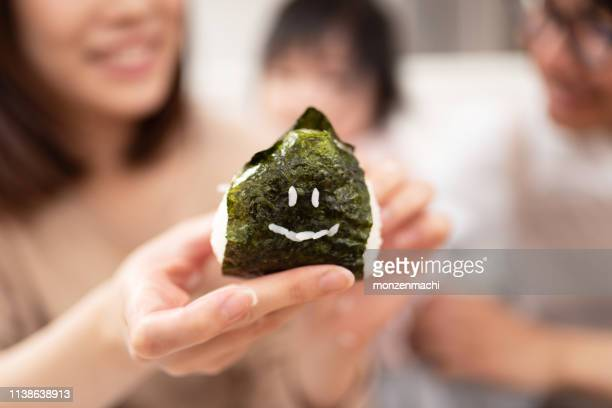 closeup of rice ball - nori stock pictures, royalty-free photos & images
