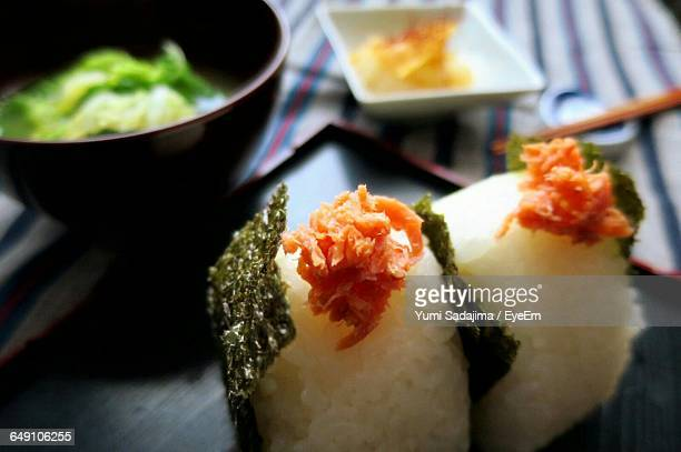 close-up of rice balls served in plate on table - rice ball stock pictures, royalty-free photos & images