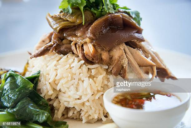 Close-up of Rice With Roasted Pork Gravy On Plate