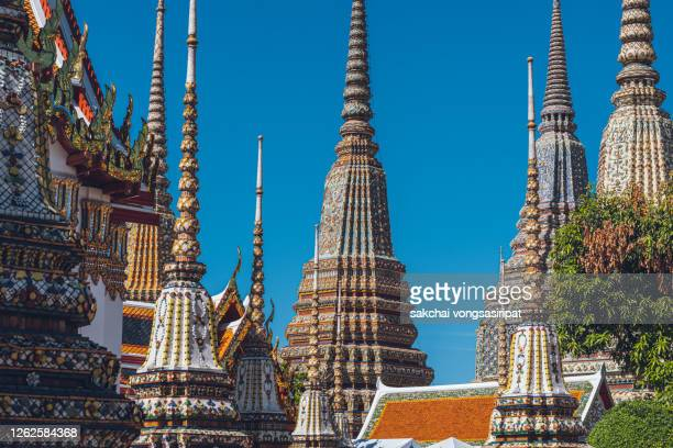 close-up of richly ornate temple structures(stupas) of the wat pho temple in bangkok,thailand, asia - wat pho stock pictures, royalty-free photos & images