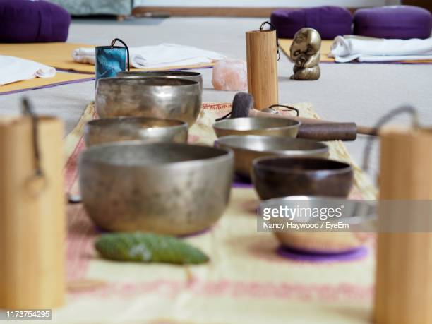 close-up of rin gongs on table - rin gong stock pictures, royalty-free photos & images