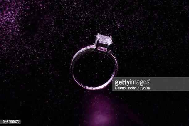 Close-Up Of Ring Against Black Background
