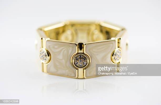 close-up of ring against white background - man made object stock pictures, royalty-free photos & images